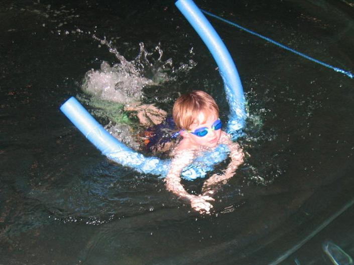 teaching a child to swim