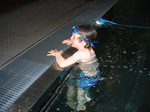 Entering the pool from a sitting position on the side